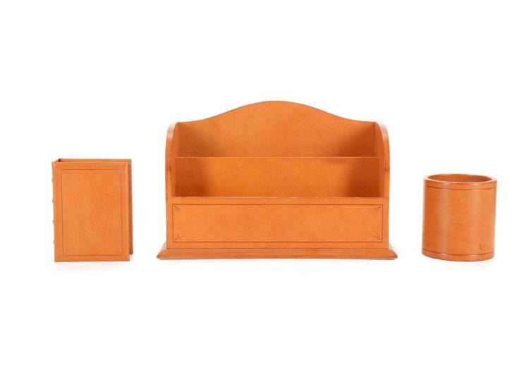 Asprey and Garrard Tan Leather Desk Set, 1990s, comprising letter rack, lidded box and pen holder (3) Box Condition Grade A Please refer to department for condition report