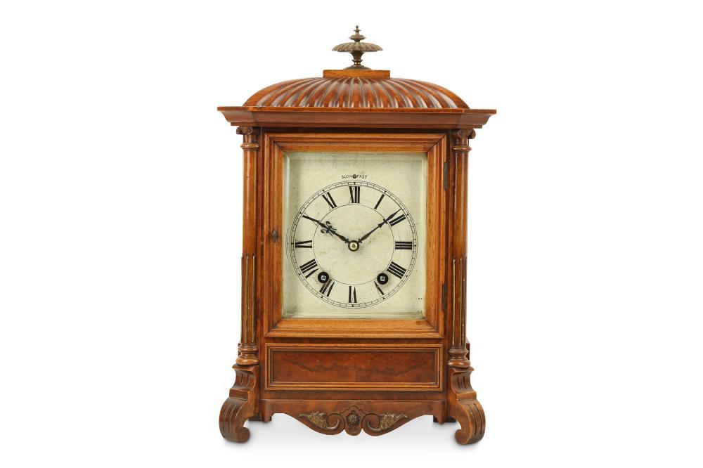 A LATE 19TH CENTURY WALNUT MANTEL CLOCK