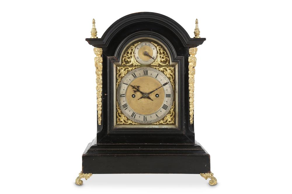 A LATE 19TH CENTURY EBONISED AND GILT BRASS MOUNTED QUARTER STRIKING FUSEE TABLE / MANTEL CLOCK