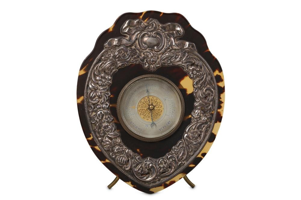 A LATE 19TH CENTURY TORTOISESHELL AND SILVER MOUNTED DESK BAROMETER