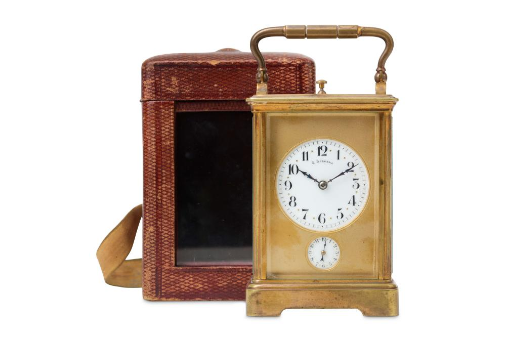 A LATE 19TH / EARLY 20TH CENTURY GILT BRASS QUARTER STRIKING CARRIAGE CLOCK WITH ALARM AND REPEAT SI