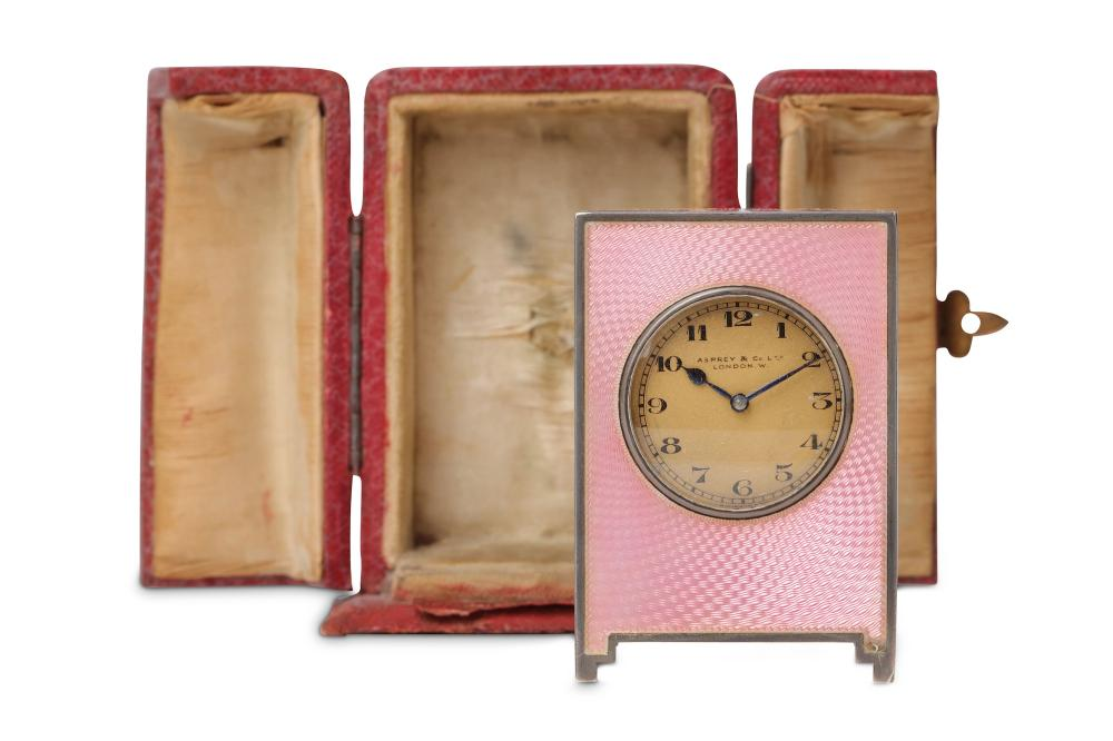 AN EARLY 20TH CENTURY SWISS SILVER AND PINK GUILLOCHE ENAMEL MINIATURE TRAVELLING CLOCK BY VALME FOR