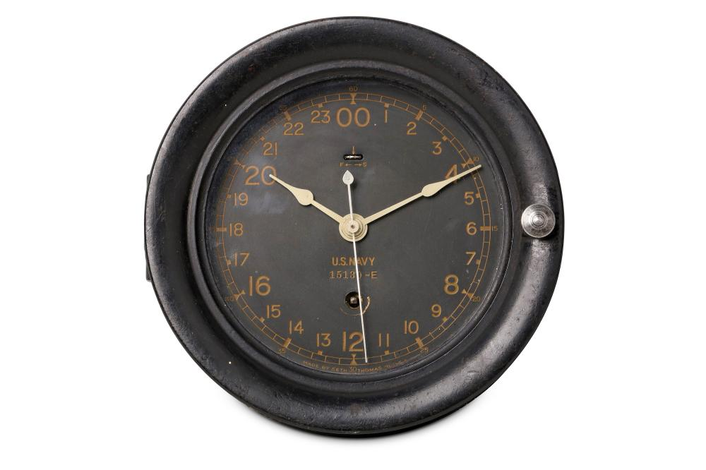 A US NAVY BULKHEAD CLOCK WITH CENTRE SECONDS BY SETH THOMAS