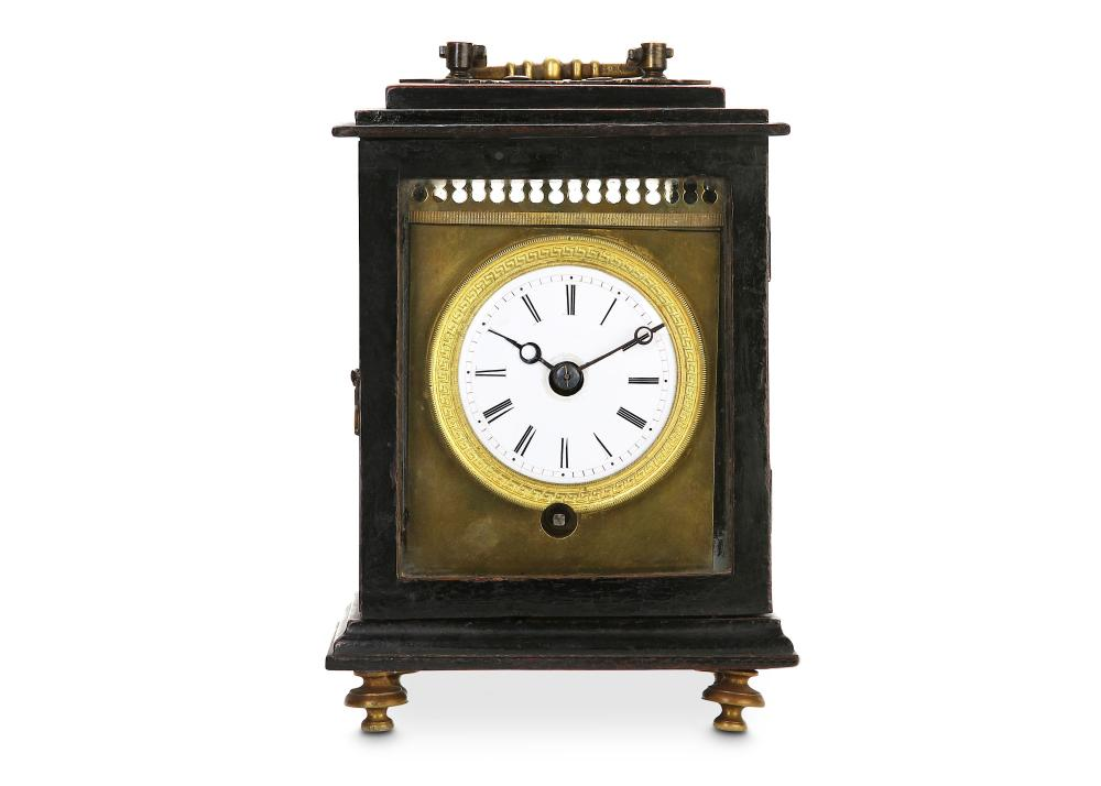 AN EARLY 19TH CENTURY GILT BRASS CAPUCINE FRENCH OFFICERS CLOCK IN LATER CASE