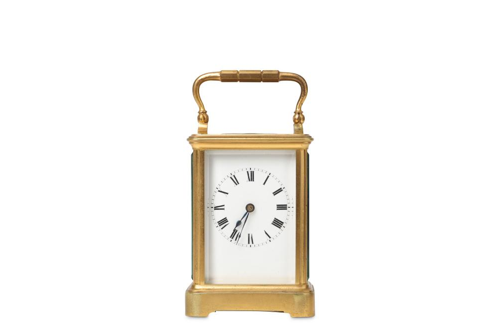 A SMALL EARLY 20TH CENTURY FRENCH GILT BRONZE CARRIAGE CLOCK BY HENRI JACOT