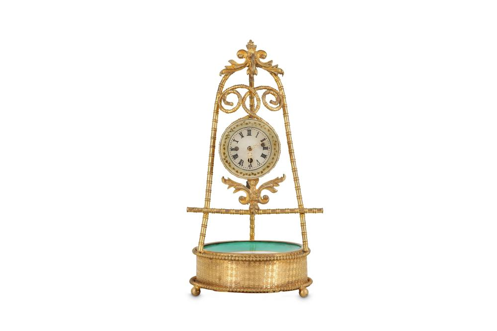 A SMALL EARLY 20TH CENTURY GILT BRASS AND PORCELAIN TRIPOD CLOCK
