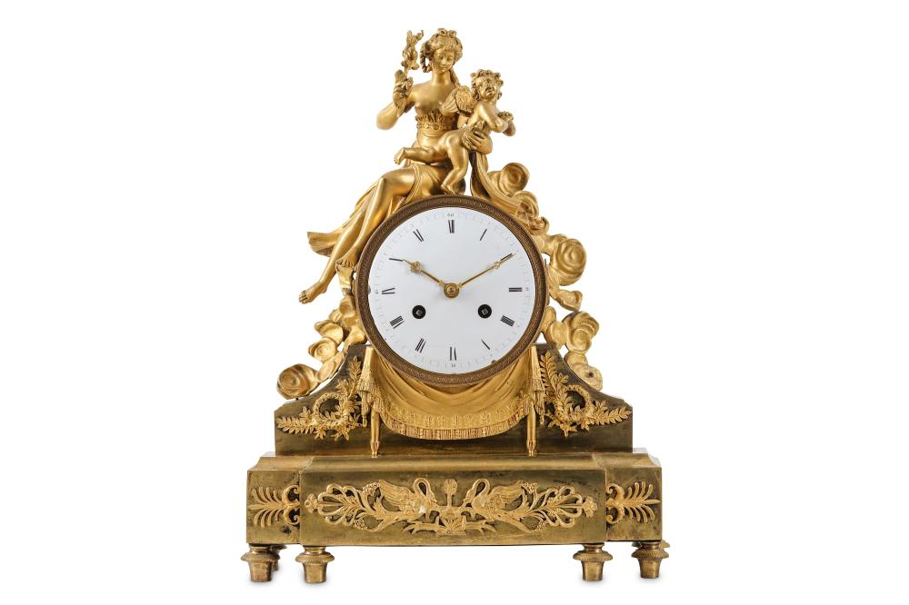 A FINE AND RARE FRENCH EMPIRE PERIOD GILT BRONZE FIGURAL MANTEL CLOCK DEPICTING THE PUNISHMENT OF CU