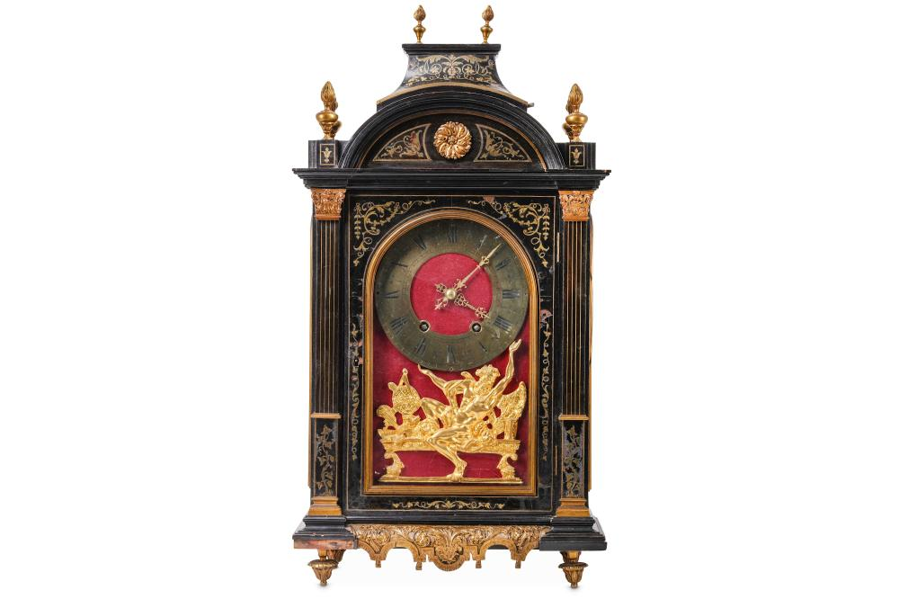 A 19TH CENTURY FRENCH EBONISED, CUT BRASS AND GILT BRONZE MOUNTED PENDULE RELIGIEUSE