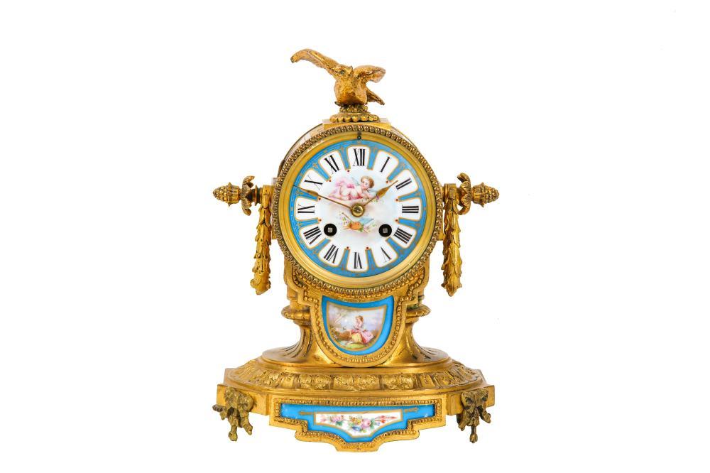 A THIRD QUARTER 19TH CENTURY FRENCH GILT BRONZE AND PORCELAIN MANTEL CLOCK
