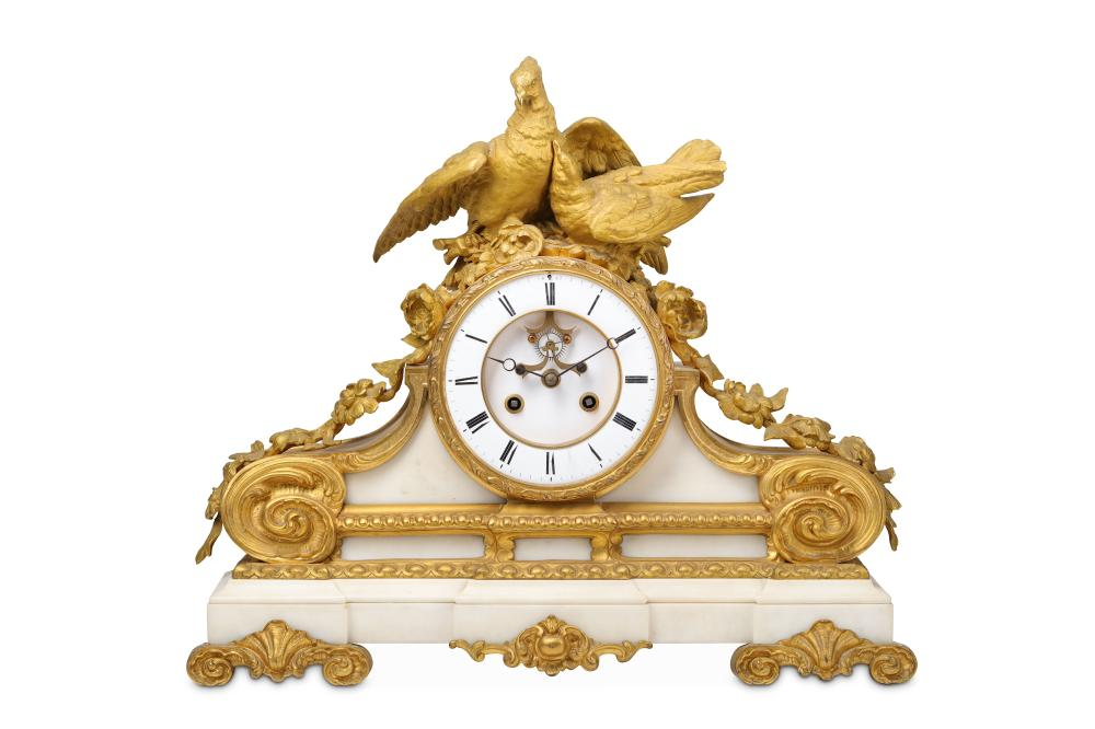 A LATE 19TH CENTURY FRENCH GILT BRONZE AND WHITE MARBLE MANTEL CLOCK DEPICTING A PAIR OF DOVES