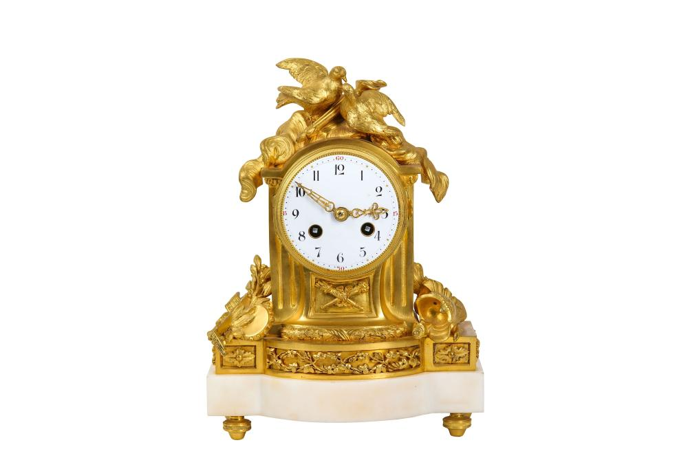 A LATE 19TH CENTURY FRENCH GILT BRONZE AND WHITE MARBLE MANTEL CLOCK