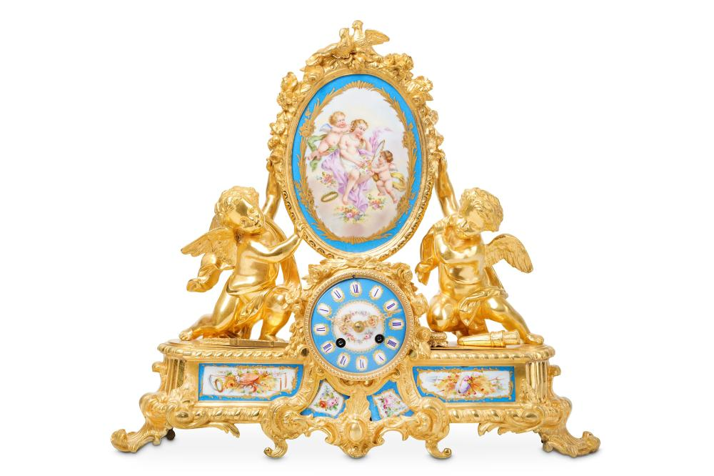 A 19TH CENTURY FRENCH GILT BRONZE AND PORCELAIN MOUNTED MANTEL CLOCK