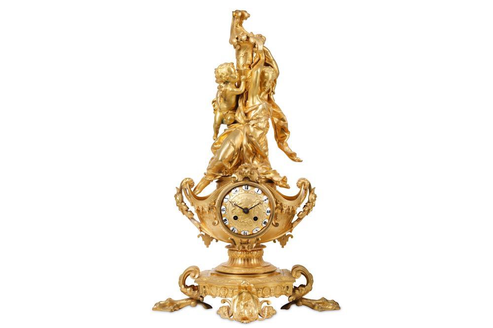 A FINE THIRD QUARTER 19TH CENTURY FRENCH GILT BRONZE FIGURAL MANTEL CLOCK