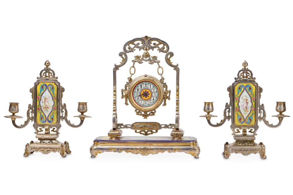 A LATE 19TH CENTURY FRENCH GILT AND SILVERED BRONZE CLOCK GARNITURE IN THE MANNER OF L'ESCALIER DE C