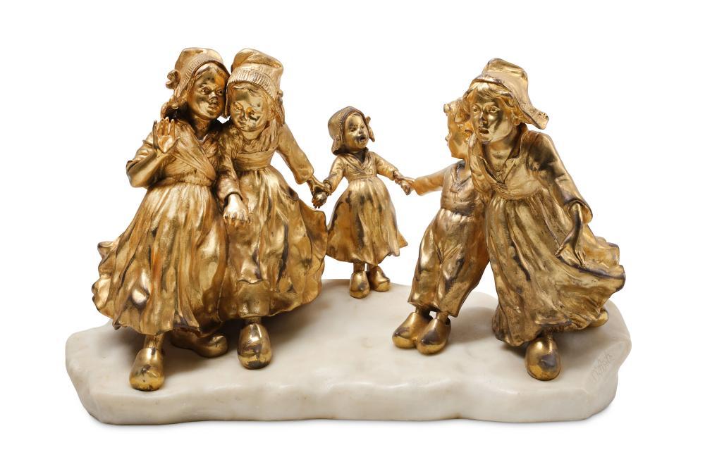 JOSEPH D'ASTE (ITALIAN, 1881-1945): A FINE GILT BRONZE AND ALABASTER FIGURAL GROUP OF CHILDREN PLAYI