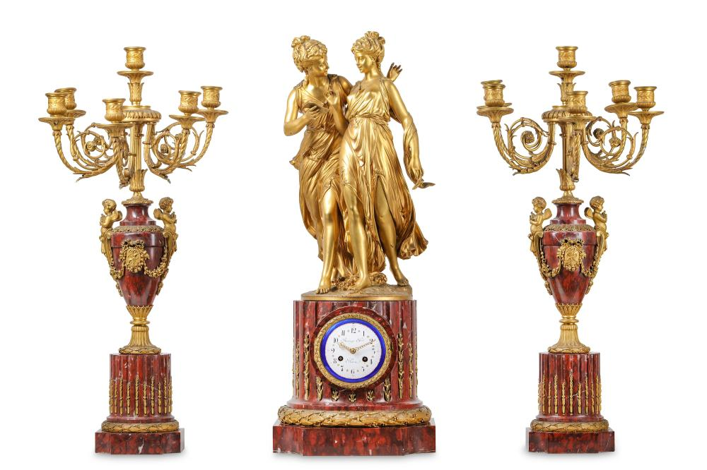 AN EXCEPTIONALLY FINE FRENCH NAPOLEON III GILT BRONZE AND ROUGE GRIOTTE MARBLE FIGURAL CLOCK GARNITU
