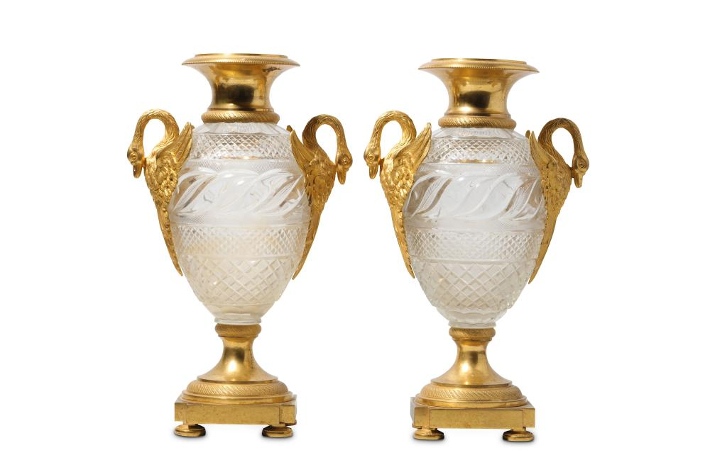 A PAIR OF RUSSIAN ORMOLU MOUNTED CUT GLASS VASES AFTER A DESIGN BY IVAN IVANOV, THE GLASS ATTRIBUTED