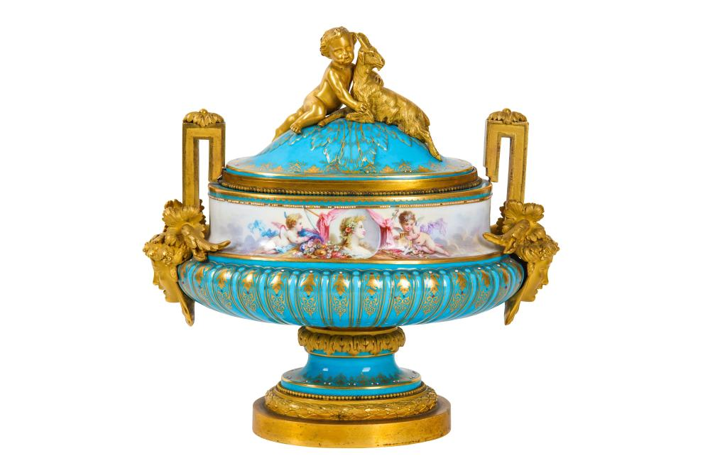 A LATE 19TH CENTURY SEVRES STYLE PORCELAIN AND GILT BRONZE MOUNTED URN AND COVER