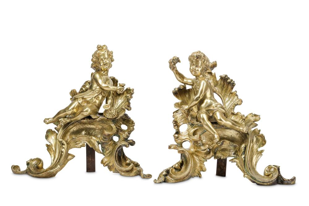 A PAIR OF 19TH CENTURY FRENCH ROCOCO STYLE GILT BRONZE CHENETS
