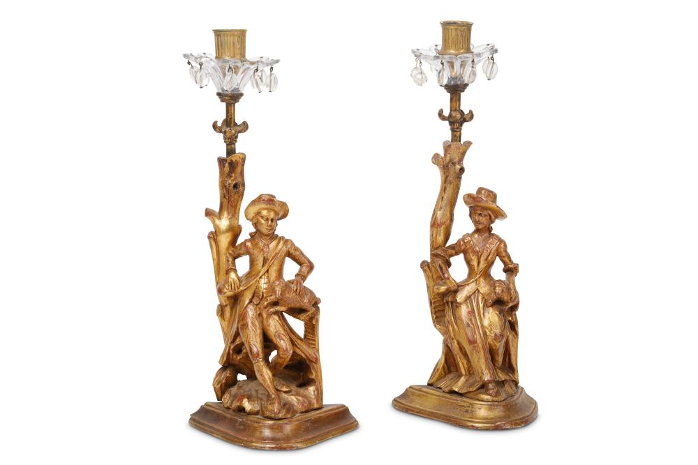 A PAIR OF 19TH CENTURY FRENCH GILTWOOD FIGURAL CANDLESTICKS