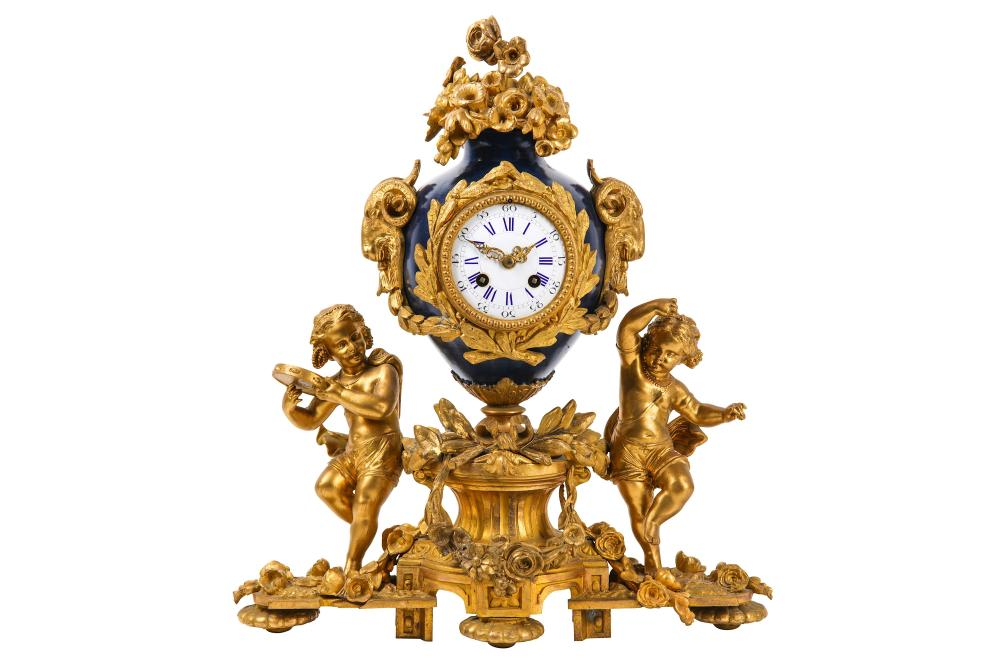 A LATE 19TH CENTURY FRENCH GILT BRONZE AND TOLE PEINTRE FIGURAL MANTEL CLOCK