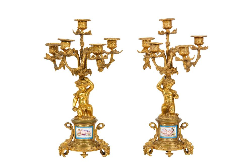 A PAIR OF LATE 19TH CENTURY FRENCH GILT BRONZE AND PORCELAIN MOUNTED CANDELABRA