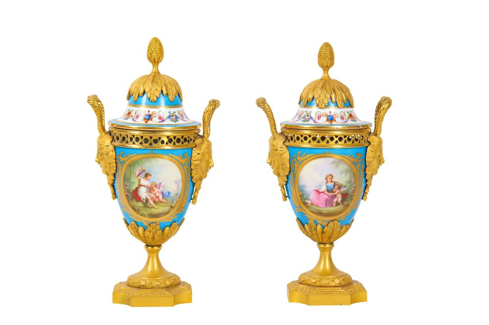 A PAIR OF LATE 19TH CENTURY FRENCH SEVRES STYLE PORCELAIN AND GILT BRONZE MOUNTED URNS AND COVERS