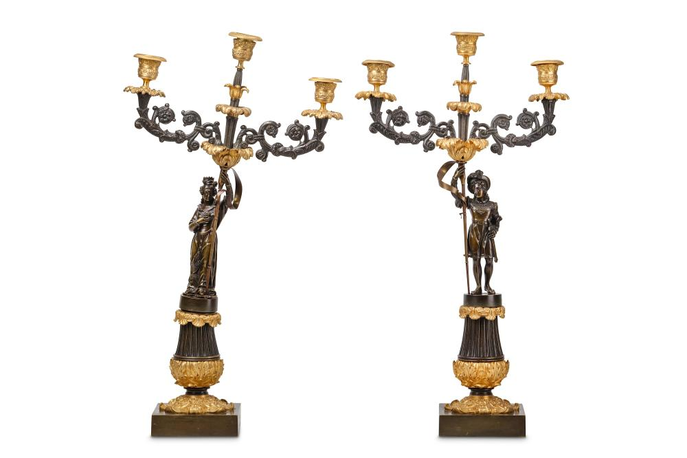A PAIR OF 19TH CENTURY FRENCH LOUIS PHILIPPE PERIOD GILT AND PATINATED BRONZE FIGURAL CANDELABRA