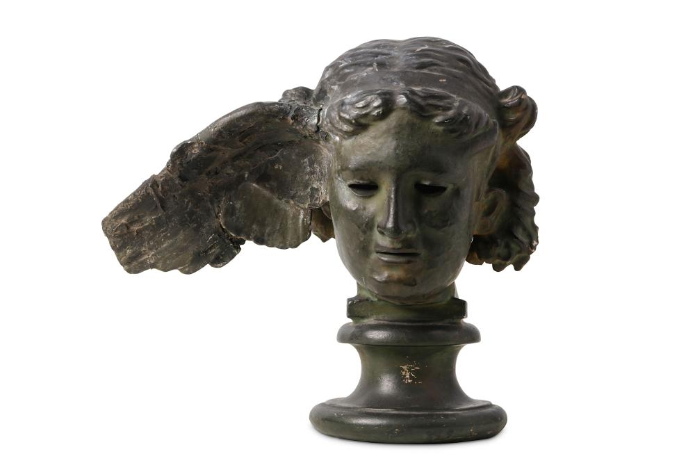 AFTER THE ANTIQUE: A LATE 19TH / EARLY 20TH CENTURY PATINATED PLASTER HEAD OF HYPNOS