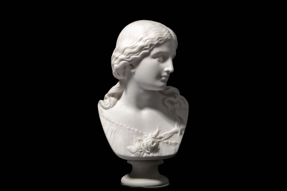 AFTER RAFFAELE MONTI (ITALIAN, 1818-1881): A COPELAND PARIAN PORCELAIN BUST OF 'LOVE'