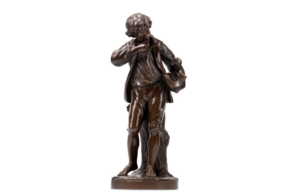 A LATE 19TH CENTURY FRENCH BRONZE FIGURE OF A MAN EATING FRUIT