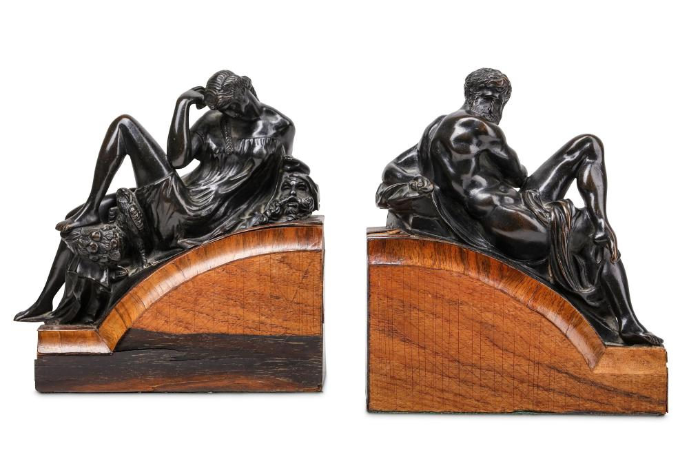 AFTER MICHELANGELO: A PAIR OF 19TH CENTURY GRAND TOUR BRONZES OF DAY AND NIGHT