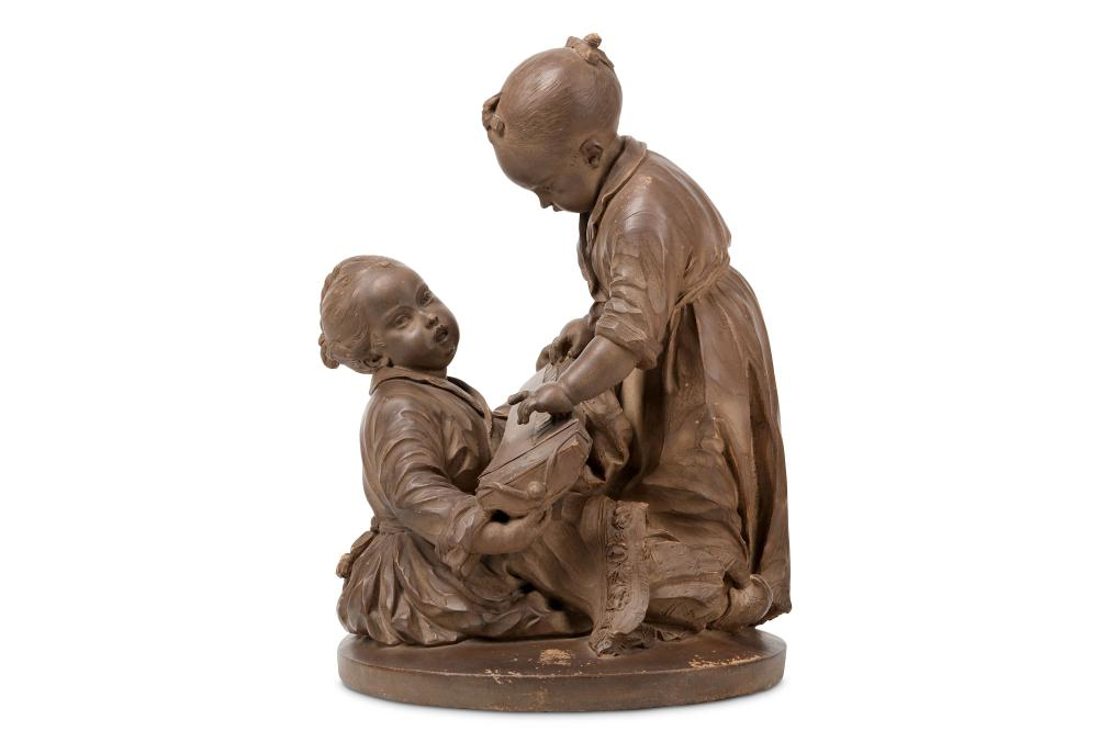 A 19TH CENTURY FRENCH TERRACOTTA MODEL OF TWO CHINESE CHILDREN PLAYING WITH AN INSTRUMENT