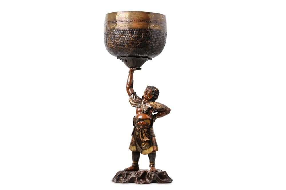 A FINE 19TH CENTURY JAPANESE MEIJI PERIOD BRONZE AND PARCEL GILT 'ONI' HOLDING ALOFT A GONG