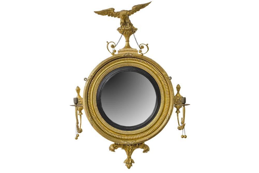 AN EARLY 19TH CENTURY REGENCY PERIOD GILTWOOD CONVEX GIRANDOLE MIRROR