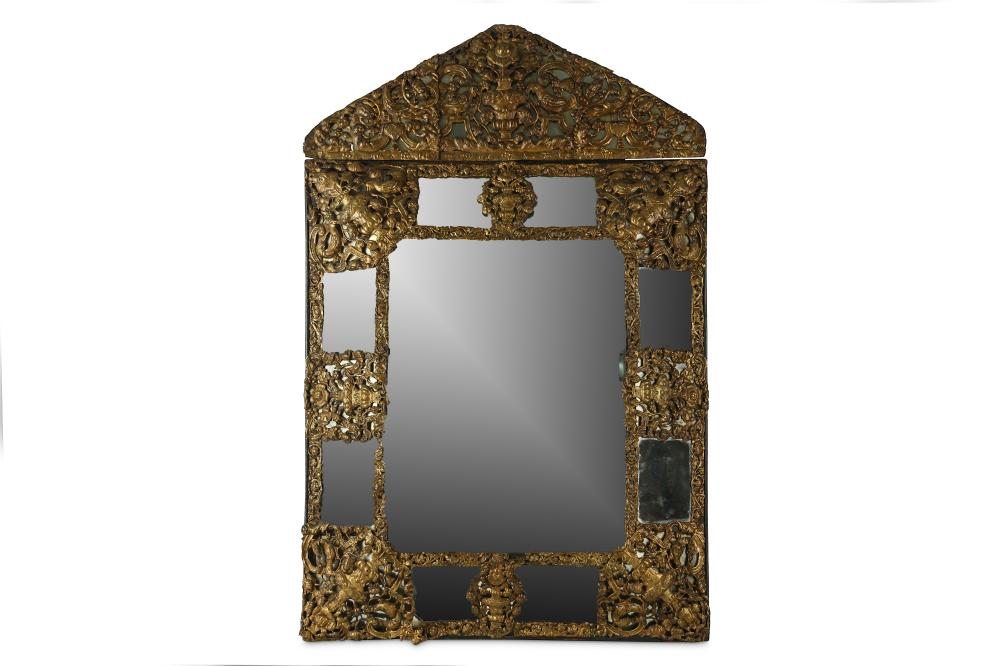 AN EARLY 18TH CENTURY FRENCH LOUIS XIV PERIOD REPOUSSE BRASS WALL MIRROR