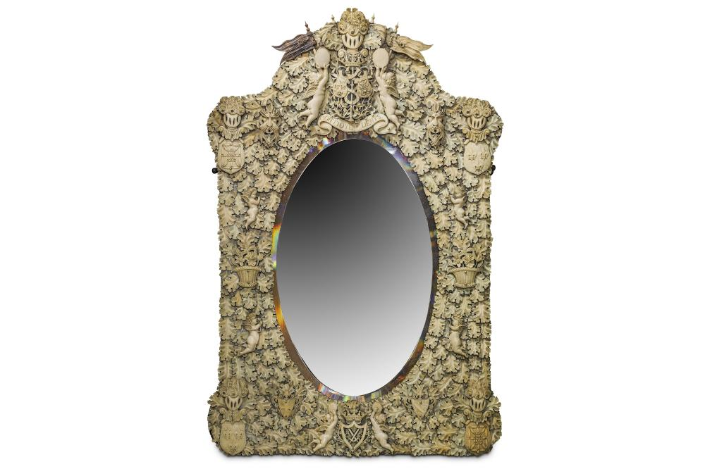 A 19TH CENTURY DIEPPE IVORY AND BONE WALL MIRROR