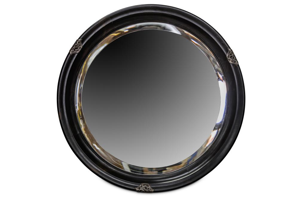 A LATE 19TH CENTURY ARTS AND CRAFTS STYLE SOLID EBONY AND SILVERED METAL MOUNTED WALL MIRROR