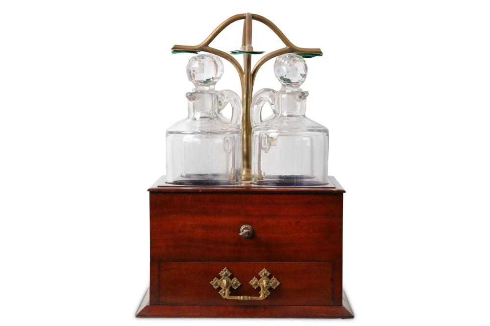 A RARE LATE 19TH CENTURY ENGLISH MAHOGANY AND BRASS 'JANITOR' FOUR BOTTLE TANTALUS