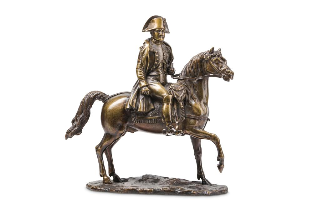 AN EARLY 19TH CENTURY BRONZE EQUESTRIAN MODEL OF NAPOLEON