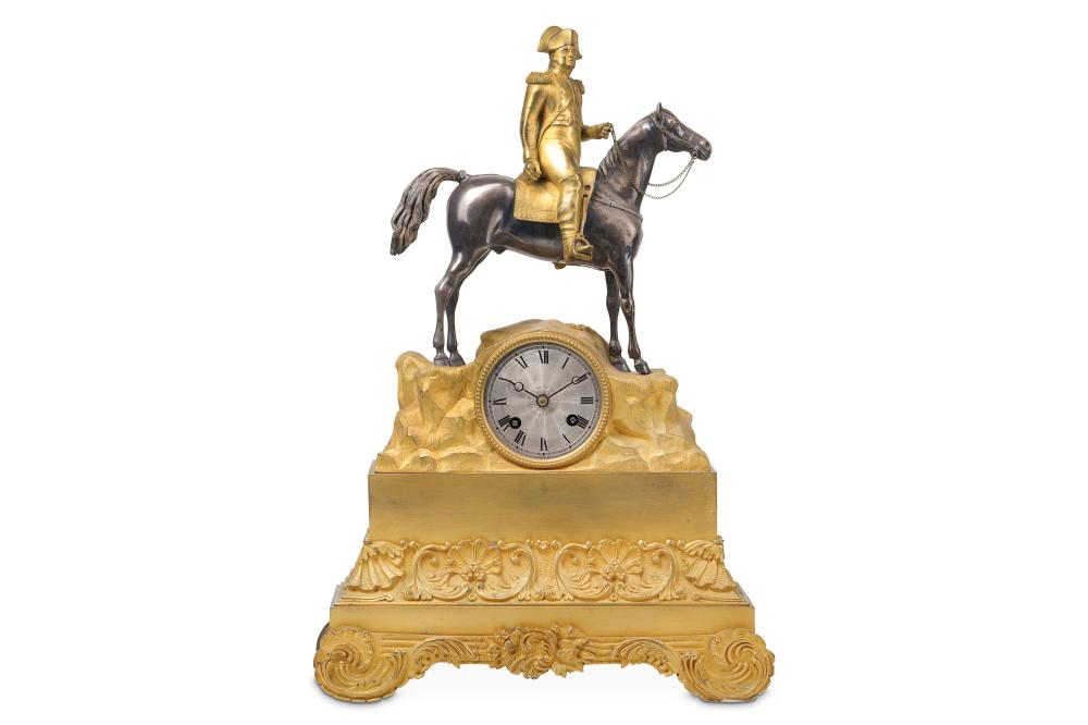 A SECOND QUARTER 19TH CENTURY FRENCH GILT AND PATINATED BRONZE EMPIRE STYLE MANTEL CLOCK OF NAPOLEON
