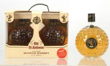 A pair of Ols St. Andrews Premium blended Scotch Whisky, 50cl, in a presentation box, with associated shot glass, and an unboxed 100cl bottle of the same (40% ABV) (2)