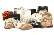 A good mixed collection of ladies handbags and vanity cases, early 20th century, many hand-embroidered or with floral and foliate needlework; together with two 1960's Art Deco style handbags, and a faux tortoiseshell example (Q)