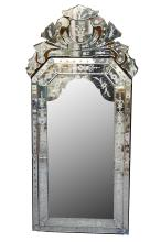 A Venetian wall mirror, early 20th Century, of typical foliate design, 140 x 60cm