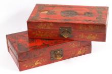 A pair of Chinese red lacquered leather hinged boxes, decorated with bats and auspicious symbols (2)