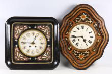 A French wall clock, late 19th Century, with a boulle inlaid face and square ebonised case, 50cm high; together with another wall clock with a lozenge shaped face and mother of pearl inlay, 63cm high (2)