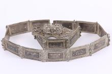 An Ottoman silver and niello belt (as seen),each plaque with scenic views, 78cm long x 3.2cm wide