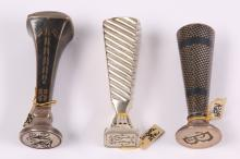 Three silver seals, early 20th century,including two silver and niello examples, the matrices engraved with initials, 7.5 cm, 6.5cm, and 7cm high (3)