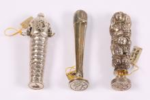 Three Continental silver seals, early 20th century,one with putti, one with a rabbit finial, and one with swags, with engraved matrices, 8.2cm, 7.5cm, and 8.2cm high (3)