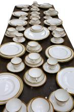 A good Coalport bone china dinner and tea service in 'Elite' pattern, 20th Century, of elegant classical design, comprising 27 dinner plates, 12 cups and saucers, a sauce boat and an oval meat platter (over 80 pieces)